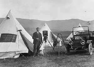 a photograph of Mr Hudson outside his studio tents